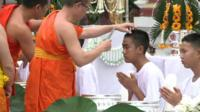 One of the Thai cave boys gets a haircut from a Buddhist monk