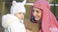 Woman dressed as shepherd and child dressed as sheep