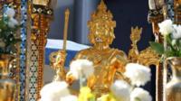 Bomb-damaged statue at shrine