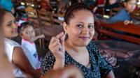 Deaf woman showing sign language in Nicaragua
