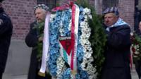 Auschwitz survivors lay wreaths at the complex on 75th anniversary of its liberation