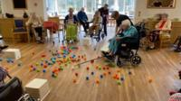 Care home residents play Hungry Hungry Hippos