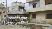 Damaged houses in Karm Al Zaytoon, a neighbourhood of Homs.