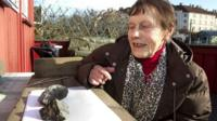 Anne Margrethe Thomassen looks at the meteorite which hit her cottage roof in Oslo