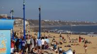 People enjoying the sun at Bournemouth beach.