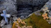 Commemorative plaque and crosses at Mount Longdon, near Stanley, where the soldiers bitterly fought during the Falklands war.