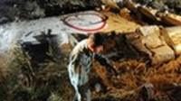 Rescue workers search through debris and fuselage
