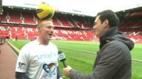 Joe interviews a man with a football on his head!