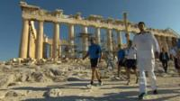 Olympic torch carried outside the Acropolis