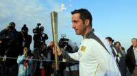 Ben Ainslie leaves from Lands End with Olympic torch