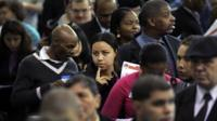 People wait in line at a job fair in the Queens borough of New York City