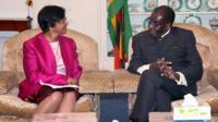 United Nations High Commissioner for Human Rights Navi Pillay, left, meets Zimbabwean President Robert Mugabe
