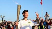 Matt Smith carrying the Olympic torch