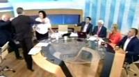 Golden Dawn spokesman Ilias Kasidiaris is seen slapping Syriza party member Rena Dorou on live TV