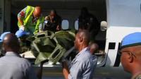 Peacekeepers' bodies are flown to Abidjan
