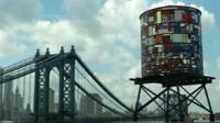 Sculpture of a water tower in Brooklyn