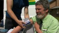 Man has blood pressure measured