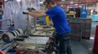 Worker in car factory