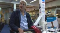 Jeremy Paxman on a mobility scooter
