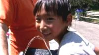 Boy and water fountain