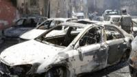 burnt out cars in Damascus