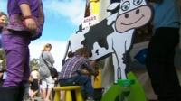 Child practices milking