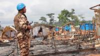UN soldier at the destroyed camp in the Ivory Coast