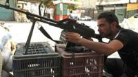 Free Syrian Army member takes position in a district of Aleppo, Syria