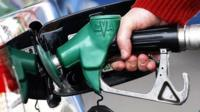 customer filling up their tank of petrol