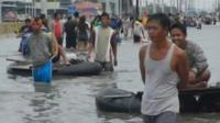 Local residents are finally able to escape heavily-flooded Manila.