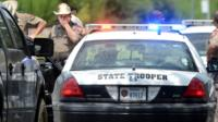 The gunman shot and killed a police officer and a civilian near a university