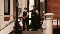 Police officers outside the Ecuadorian Embassy in London
