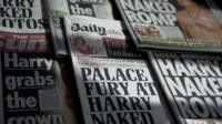 arrangement of newspaper front pages about Prince Harry