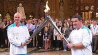 Roy Kerwin and Alan Richardson carry Paralympic flame