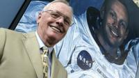 US astronaut Neil Armstrong poses in front of his photograph