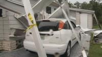 A car damaged by Tropical Storm Isaac