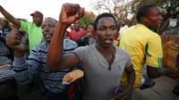 Miners and their supporters dance after being released outside the court