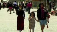 La Paz residents walking down a road