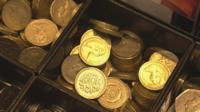 Money in cash register in shop