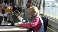 A women working at a sewing machine