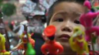 Young boy looking at toys
