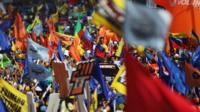 Henrique Capriles surrounded by flags