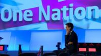Ed Miliband in front of One Nation slogan