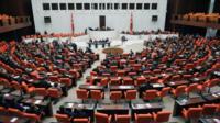 Turkey's lawmakers debate in parliament in Ankara (4 Oct)