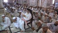 Pakistanis pray