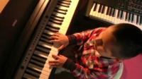 Jose Andre Montano Baina playing the piano