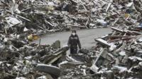 Person surrounded by rubble