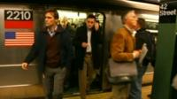 Commuters getting off New York subway at 42nd Street