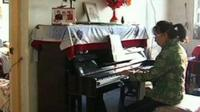 Xie Guizhi playing her piano