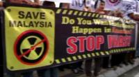 Activists demonstrate against the rare earth refinery